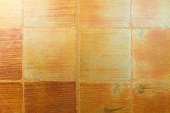 鈍い輝きが印象的な金箔風の壁紙。