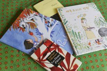 アンジェリックさんの作品たち。韓国語に翻訳された絵本も。