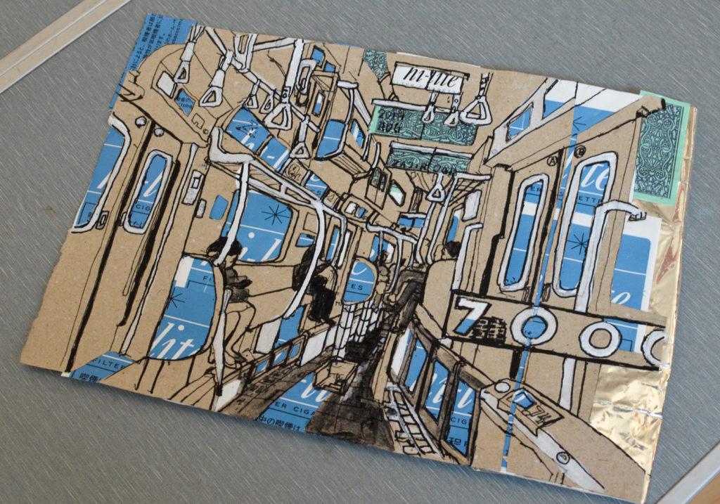 地下鉄の東西線をイメージしてつくった作品。タバコのハイライトの包み紙を使っている。